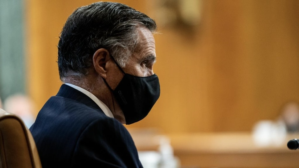 Senator Mitt Romney, a Republican from Utah, center, wears a protective mask during a Senate Budget Committee confirmation hearing for Neera Tanden, director of the Office and Management and Budget (OMB) nominee for U.S. President Joe Biden, in Washington, D.C., U.S., on Wednesday, Feb. 10, 2021. Tanden apologized for partisan tweets, pledged to distribute stimulus checks quickly, and defended her stance on Wall Street and Silicon Valley's influence in yesterday's hearing on her nomination to lead the OMB. Photographer: Anna Moneymaker/The New York Times/Bloomberg