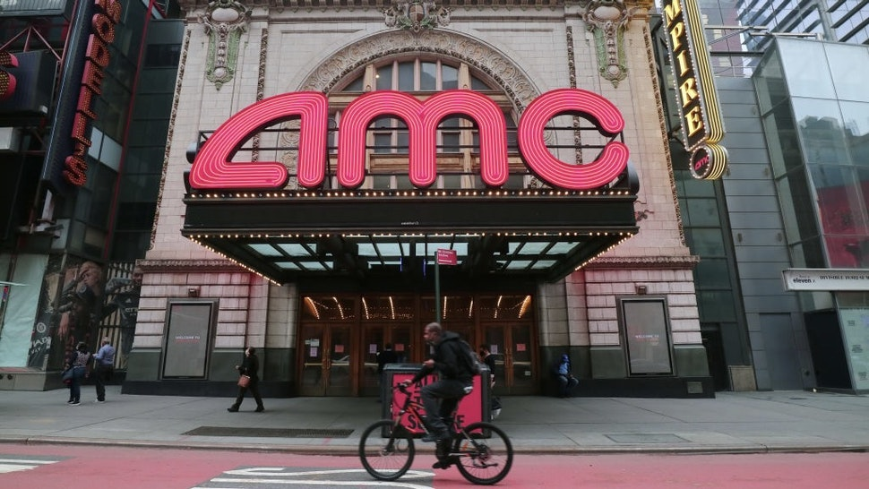 NEW YORK, NY - OCTOBER 22: A person rides his bicycle past the closed AMC movie theaters in Times Square on October 22, 2020 in New York City . (Photo by Gary Hershorn/Getty Images)