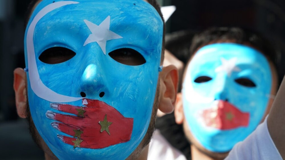 TOPSHOT - People protest at a Uyghur rally on February 5, 2019 in front of the US Mission to the United Nations, to encourage the State Department to fight for the freedom of the majority-Muslim Uighur population unjustly imprisoned in Chinese concentration camps.
