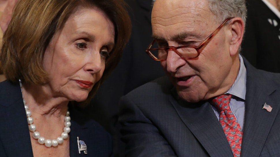 WASHINGTON, DC - MAY 15: Speaker of the House Nancy Pelosi (D-CA) (L) and Senate Minority Leader Charles Schumer (D-NY) lead a rally and news conference ahead of a House vote on health care and prescription drug legislation in the Rayburn Room at the U.S. Capitol May 15, 2019 in Washington, DC. The bicameral group of Democrats urged Senate Majority Leader Mitch McConnell (R-KY) to bring the Strengthening Health Care and Lowering Prescription Drug Costs Act up for a vote in the Senate.