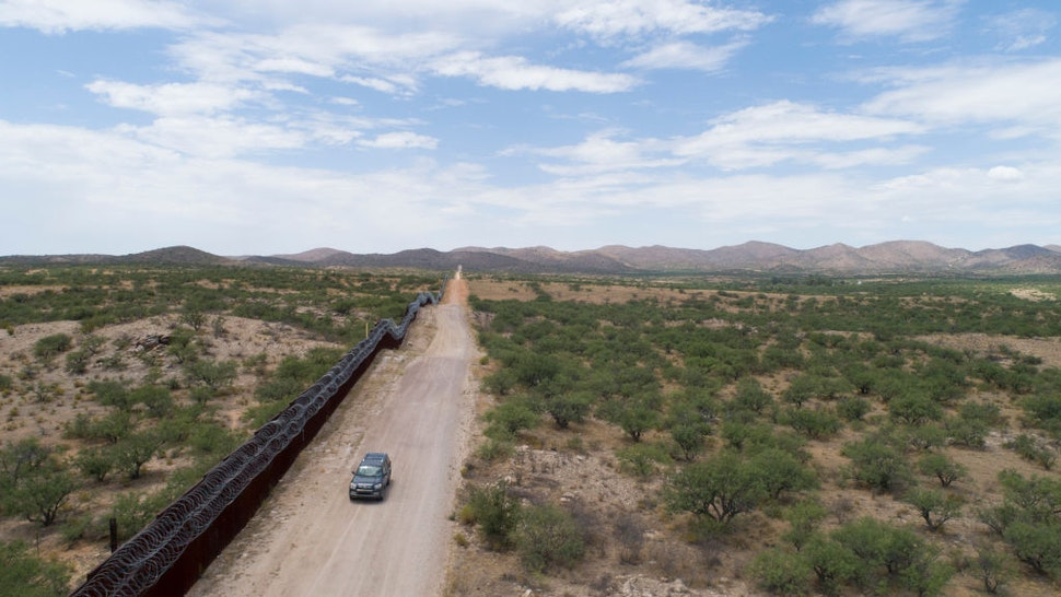 A Green Valley-Sahuarita Samaritans vehicle patrols the border fence in Sasabe, Arizona, on July 14, 2019. - Volunteers of the Green Valley-Sahuarita Samaritans offer humanitarian aid to migrants in the Arizona-Sonora borderlands with Mexico. (Photo by Daniel Woolfolk for AFP / AFP) (Photo credit should read DANIEL WOOLFOLK FOR AFP/AFP via Getty Images)