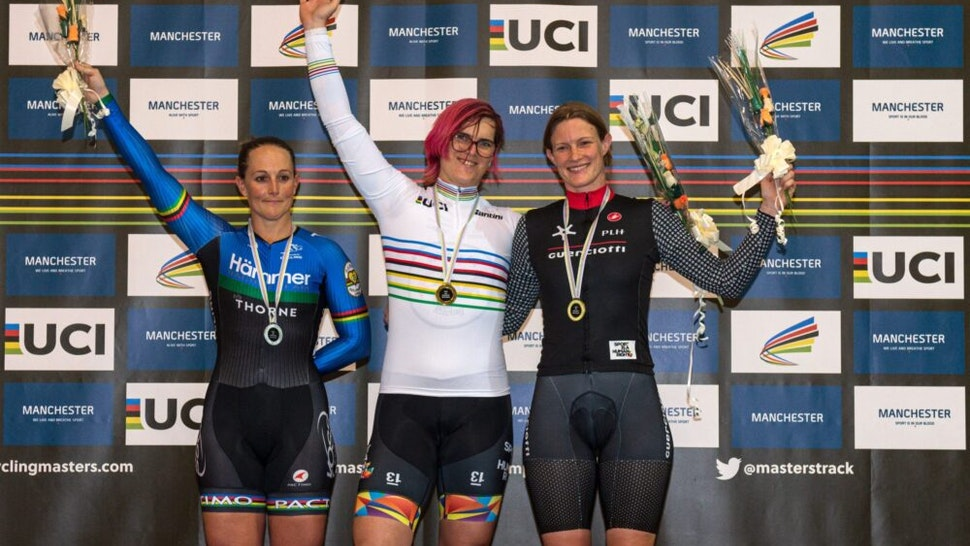 Canadian cyclist Rachel McKinnon (C) celebrates her gold medal on the podium with bronze medalist Kirsten Herup Sovang (R) of Denmark and silver medalist Dawn Orwick (L) of the USA, for the F35-39 Sprint discipline of the UCI Masters Track Cycling World Championships, in Manchester on October 19, 2019. - Transgender cyclist Rachel McKinnon has defended her right to compete in women's sport despite accepting trans athletes may retain a physical advantage over their rivals.