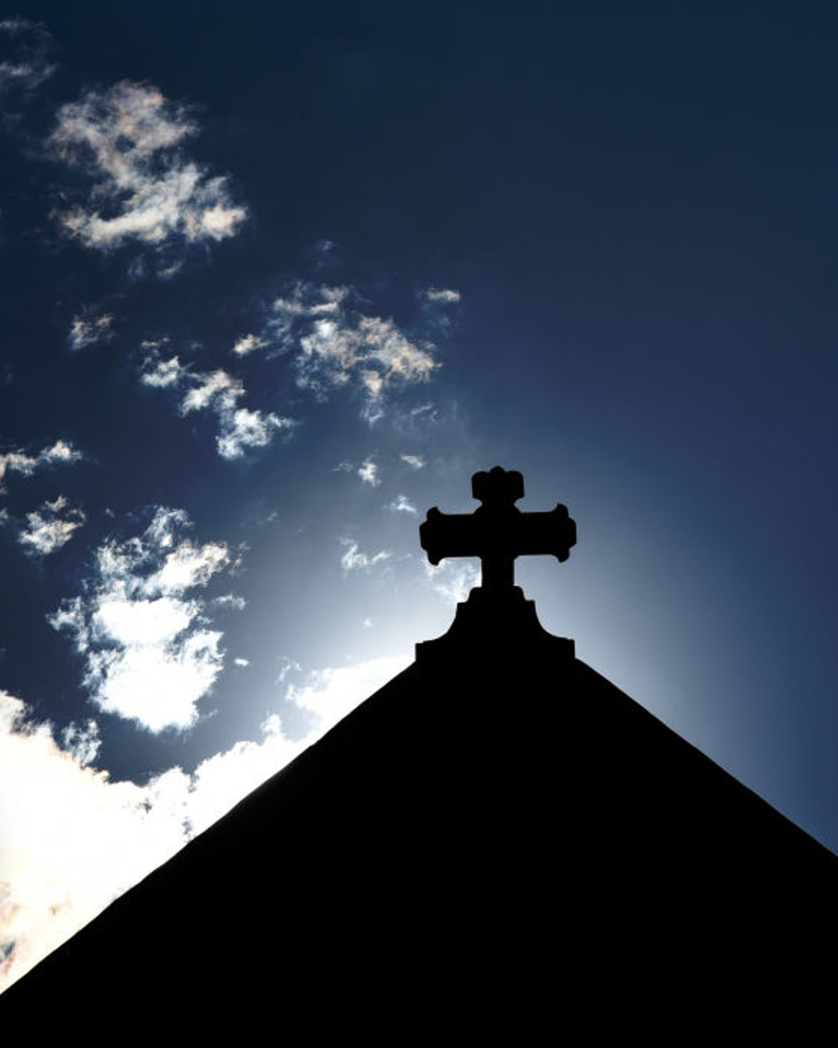 SANTA FE, NEW MEXICO - AUGUST 17, 2019: The morning sun rises behind a cross atop a Catholic church in Santa Fe, Newico. (Photo by Robert Alexander/Getty Images)