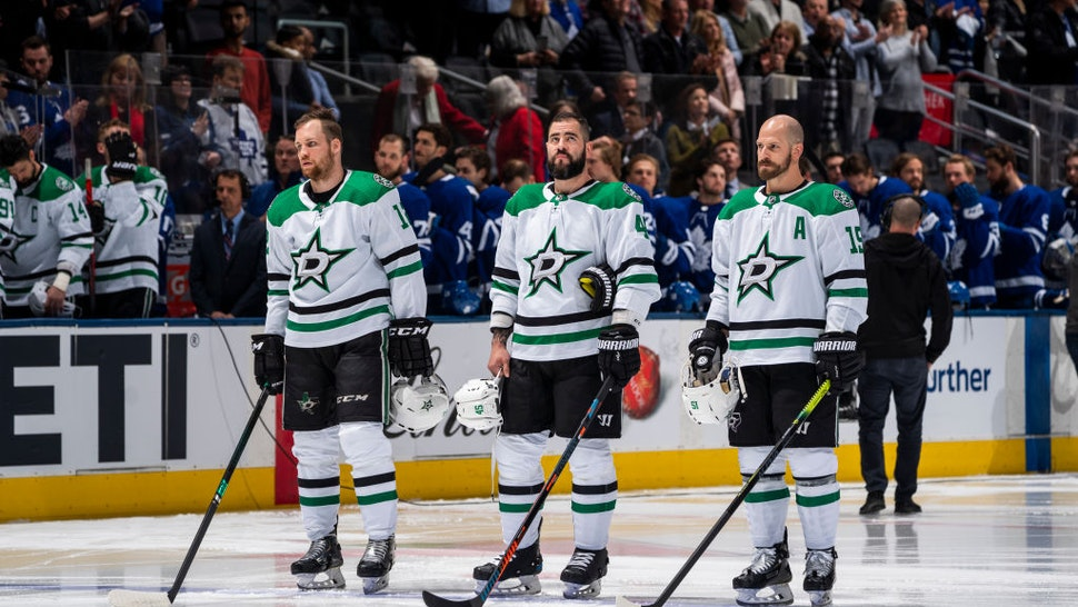 Radek Faksa #12, Roman Polak #45 and Blake Comeau #15 of the Dallas Stars stand for the national anthems before the start o the first period against the Toronto Maple Leafs at the Scotiabank Arena on February 13, 2020 in Toronto, Ontario, Canada.