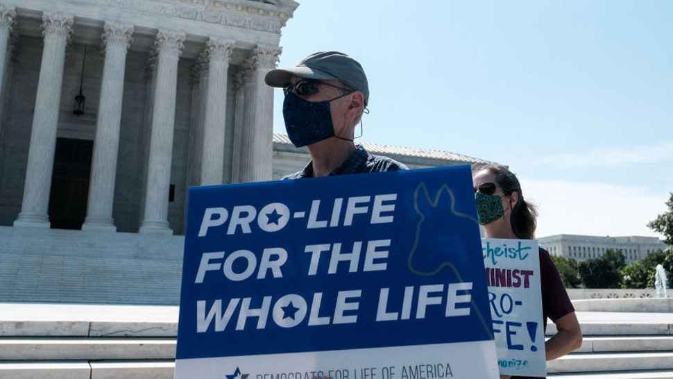 WASHINGTON, DC - JUNE 25: Pro-life activists stage a protest in front of the U.S. Supreme Court June 25, 2020 in Washington, DC. The Supreme Court is expected to issue a ruling on abortion rights soon. (Photo by Michael A. McCoy/Getty Images)