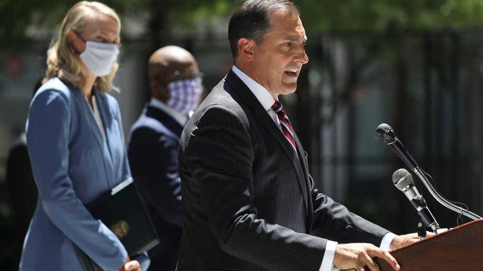 U.S. Attorney John Lausch, right, announces a major fine against ComEd for bribery involving Illinois politicians, during a news conference in the courtyard of the Dirksen U.S. Courthouse in Chicago, Ill. on Friday, July 17, 2020. (Abel Uribe/Chicago Tribune/Tribune News Service via Getty Images)