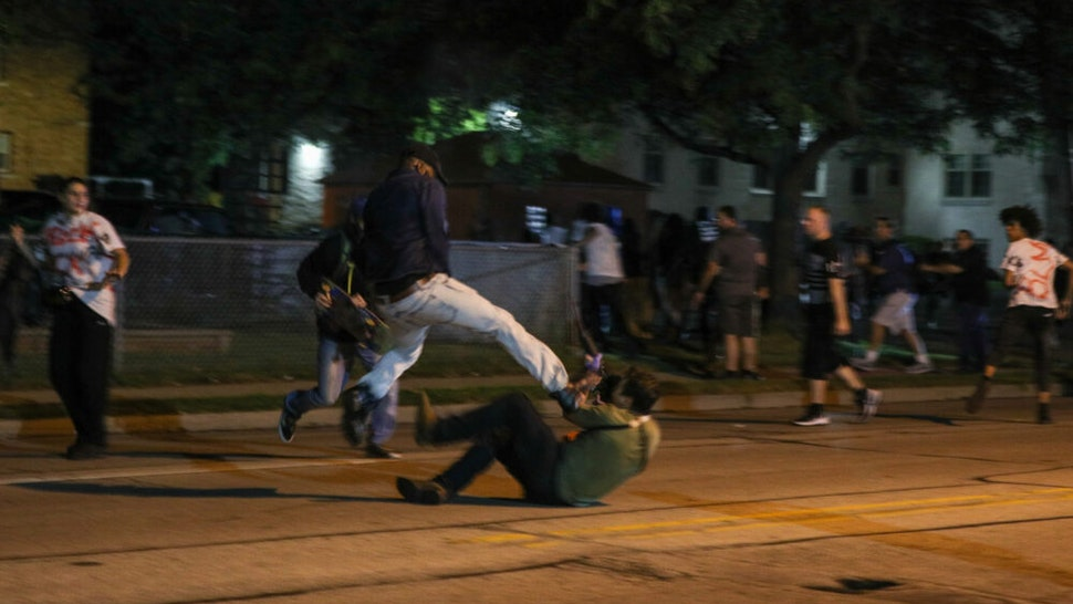 KENOSHA, WISCONSIN, USA - AUGUST 25: (EDITORS NOTE: Image contains graphic content.) A protester clashes with armed civilian Kyle Rittenhouse during confrontations between protesters and armed civilians, who claimed to protect the streets of Kenosha against the arson, during the third day of protests over the shooting of a black man Jacob Blake by police officer in Wisconsin, United States on August 25, 2020. Kyle Rittenhouse has been charged by Wisconsin prosecutors with the killing of Anthony Huber, 26 and Joseph Rosenbaum, 36 and the injuring of Gaige Grosskreutz, also 26.