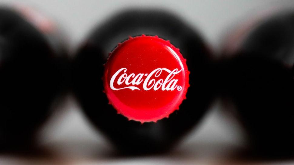 Coca-Cola bottles are seen in this illustration photo taken in Krakow, Poland on October 8, 2020. (Photo Illustration by Jakub Porzycki/NurPhoto via Getty Images)