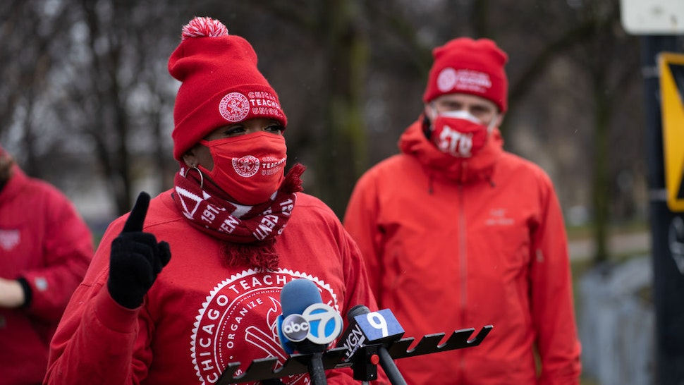 Former teacher Tara Stamps speaks ahead of a car caravan where teachers and supporters gathered to demand a safe and equitable return to in-person learning during the COVID-19 pandemic in Chicago, IL on December 12, 2020. Select Chicago public schools teachers are expected to return to classrooms on January 4th, 2021. (Photo by Max Herman/NurPhoto via Getty Images)