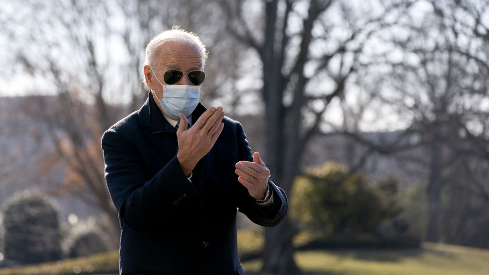 U.S. President Joe Biden wears a protective mask while speaking to members of the media on the South Lawn of the White House after arriving on Marine One in Washington, D.C., U.S., on Monday, Feb. 8, 2021.