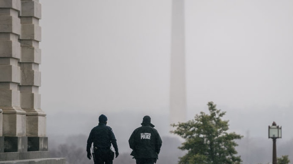 WASHINGTON, DC - FEBRUARY 13: Capitol Police officers patrol the U.S. Capitol grounds following the conclusion of the second impeachment trial of former President Donald Trump on February 13, 2021 in Washington, DC. The Senate voted 57-43 to acquit Trump. (Photo by Brandon Bell/Getty Images)