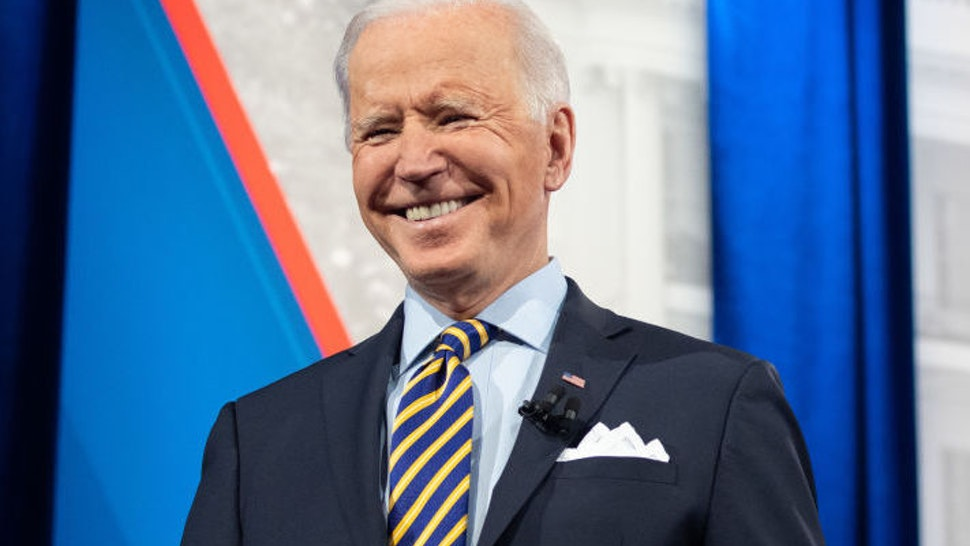 US President Joe Biden holds a face mask as he participates in a CNN town hall at the Pabst Theater in Milwaukee, Wisconsin, February 16, 2021.