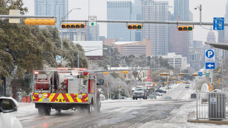 A firetruck drives down Congress Avenue in Austin, Texas, U.S., on Wednesday, Feb. 17, 2021. The crisis that has knocked out power for days to millions of homes and businesses in Texas and across the central U.S. is getting worse, with blackouts expected to last until at least Thursday. Photographer: Thomas Ryan Allison/Bloomberg via Getty Images