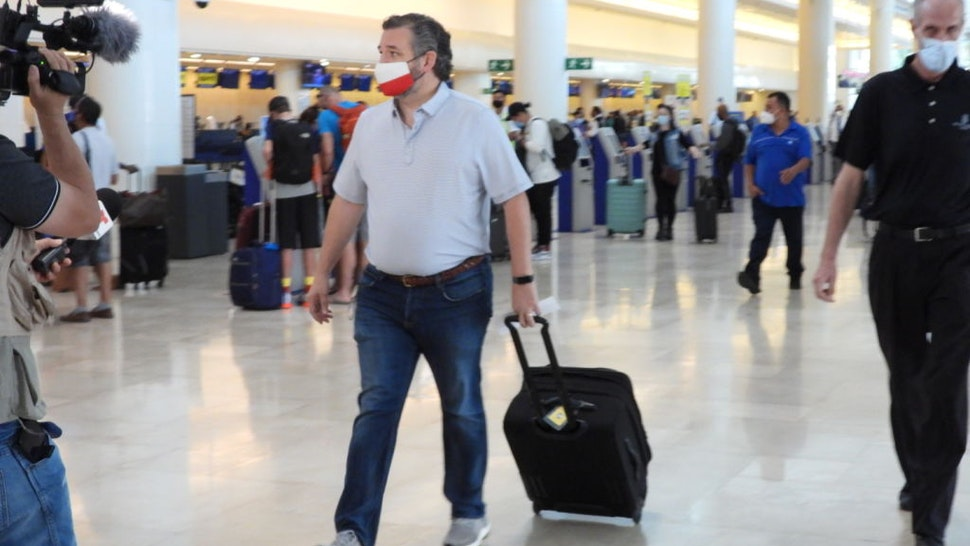 Sen. Ted Cruz (R-TX) checks in for a flight at Cancun International Airport after a backlash over his Mexican family vacation as his home state of Texas endured a Winter storm on February 18, 2021 in Cancun, Quintana Roo, Mexico.