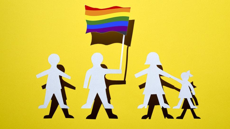 "Paper human likeness flies the rainbow flag concept.Studio Shot ""n"