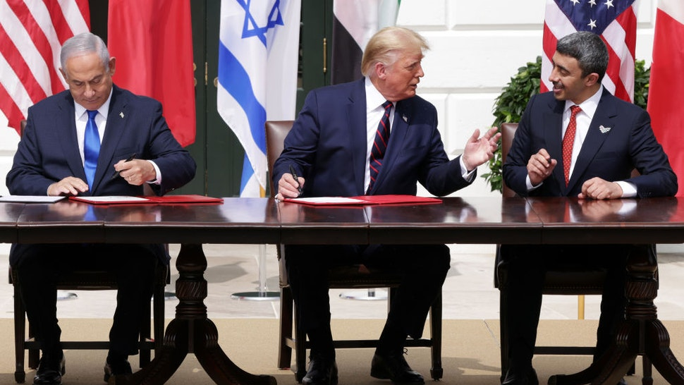 WASHINGTON, DC - SEPTEMBER 15: (L-R) Prime Minister of Israel Benjamin Netanyahu, U.S. President Donald Trump, and Foreign Affairs Minister of the United Arab Emirates Abdullah bin Zayed bin Sultan Al Nahyan participate in the signing ceremony of the Abraham Accords on the South Lawn of the White House on September 15, 2020 in Washington, DC. Witnessed by President Trump, Prime Minister Netanyahu signed a peace deal with the UAE and a declaration of intent to make peace with Bahrain. (Photo by Alex Wong/Getty Images)