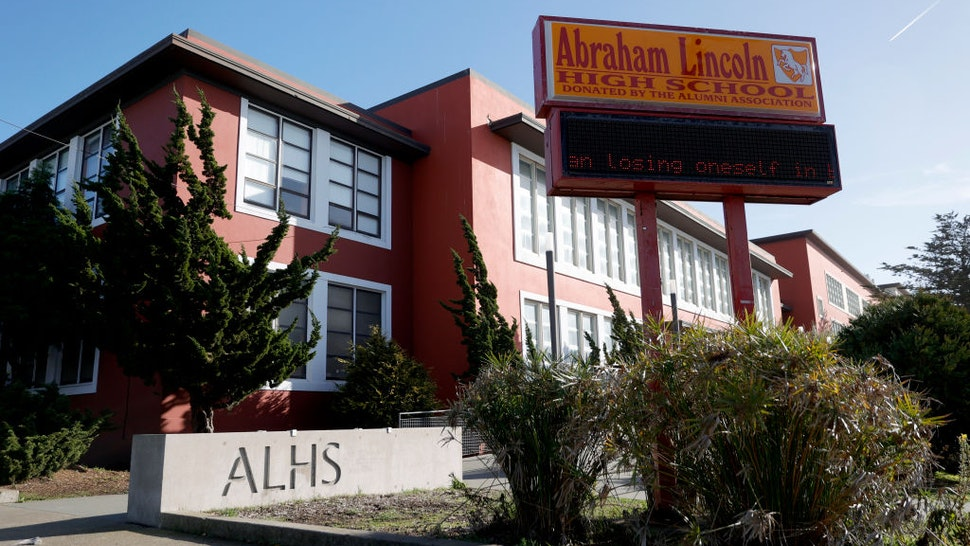 A sign is posted outside of Abraham Lincoln High School on December 17, 2020 in San Francisco, California.