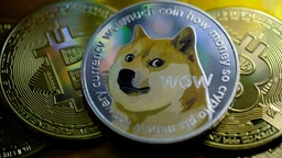 KATWIJK, NETHERLANDS - JANUARY 29: In this photo illustration, visual representations of digital cryptocurrencies, Dogecoin and Bitcoin are arranged on January 29, 2021 in Katwijk, Netherlands.