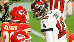 TAMPA, FLORIDA - FEBRUARY 07: Tom Brady #12 of the Tampa Bay Buccaneers speaks to Tyrann Mathieu #32 of the Kansas City Chiefs during the second quarter in Super Bowl LV at Raymond James Stadium on February 07, 2021 in Tampa, Florida. (Photo by Kevin C. Cox/Getty Images)