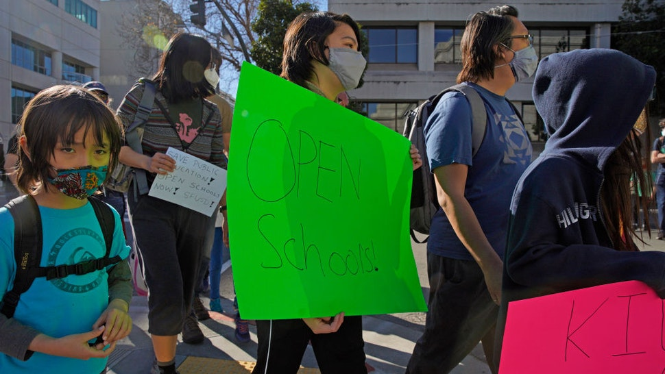 Calder Law, 12, who attends Roosevelt Middle School, marches back to City Hall after a rally outside the SFUSD building, Saturday, Feb. 6, 2021, in San Francisco, Calif.