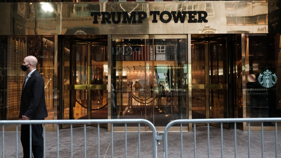 People walk past the Trump Tower as the impeachment trial of Donald Trump begins in Washington on February 09, 2021 in New York City.