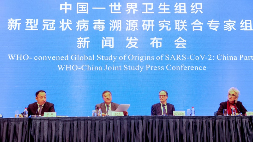 Experts from the WHO-China joint team Mi Feng, Liang Wannian, Peter Ben Embarek and Marion Koopmans attend the WHO-China Joint Study Press Conference on February 9, 2021 in Wuhan, Hubei Province of China.