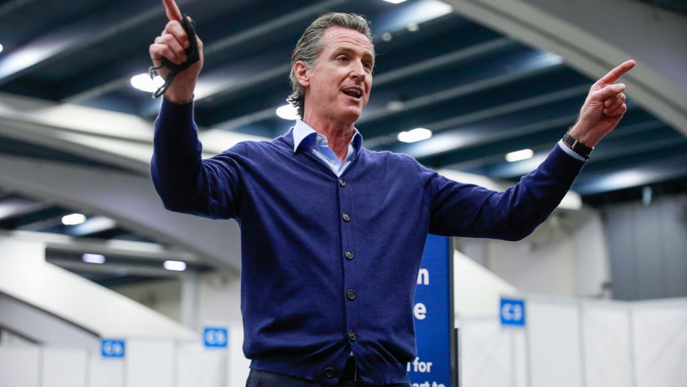 Governor Gavin Newsom speaks to the press at the Moscone Center vaccination site on Friday, Feb. 12, 2021 in San Francisco, California.