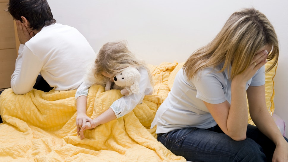 Crisis in parent's relationship, daughter suffering from it - stock photo