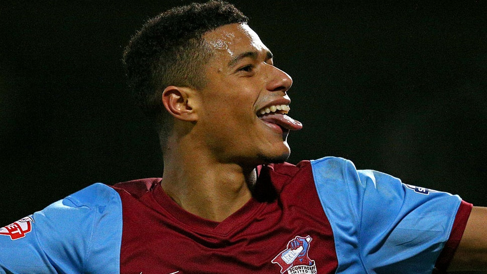 Lyle Taylor of Scunthorpe celebrates after scoring his team's second goal during the FA Cup Third Round match between Scunthorpe United and Chesterfield FC at Glanford Park on January 6, 2015 in Scunthorpe, England.