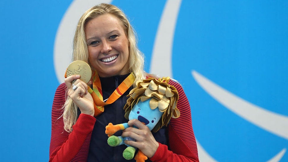 Gold medalist Jessica Long of the United States celebrates on the podium at the medal ceremony for Women's 200m Individual Medley - SM8 on day 10 of the Rio 2016 Paralympic Games at the Olympic Aquatics Stadium on September 17, 2016 in Rio de Janeiro, Brazil.