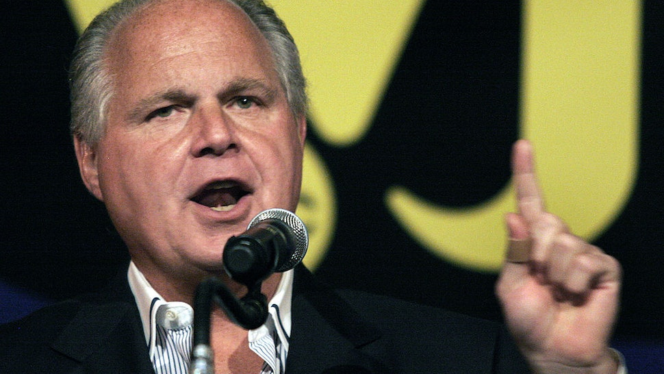 """NOVI, MI - MAY 3: Radio talk show host and conservative commentator Rush Limbaugh speaks at """"An Evenining With Rush Limbaugh"""" event May 3, 2007 in Novi, Michigan. The event was sponsored by WJR radio station as part of their 85th birthday celebration festivities. (Photo by Bill Pugliano/Getty Images)"""