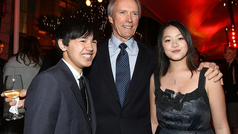"BURBANK, CA - DECEMBER 09: Actor Bee Vang, director Clint Eastwood and actress Ahney Her attend the after party for the world premiere of Warner Bros. Pictures' ""Gran Torino"" held at Warner Bros. Studios on December 9, 2008 in Burbank, California. (Photo by Alberto E. Rodriguez/Getty Images)"