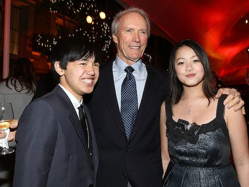 """BURBANK, CA - DECEMBER 09: Actor Bee Vang, director Clint Eastwood and actress Ahney Her attend the after party for the world premiere of Warner Bros. Pictures' """"Gran Torino"""" held at Warner Bros. Studios on December 9, 2008 in Burbank, California. (Photo by Alberto E. Rodriguez/Getty Images)"""