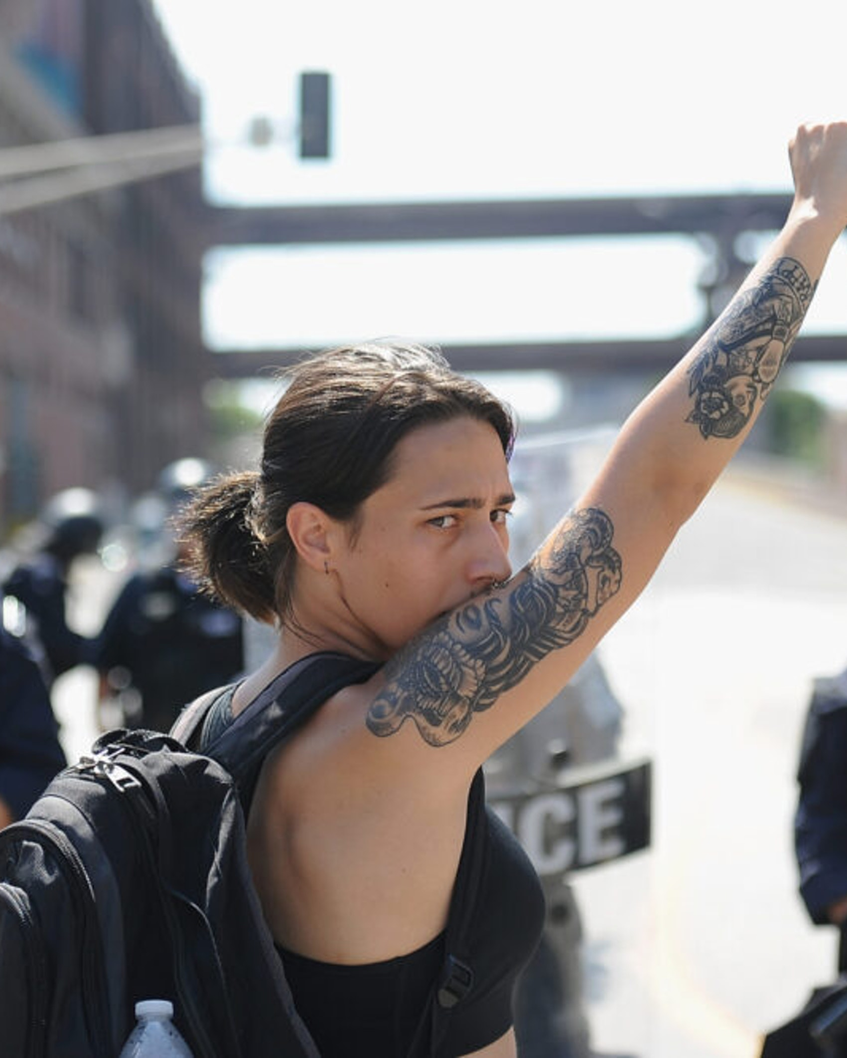ST. LOUIS, MO - SEPTEMBER 15: A woman raises her fist as she approaches a line of police officers in riot gear during a protest action following a not guilty verdict on September 15, 2017 in St. Louis, Missouri. Protests erupted today following the acquittal of former St. Louis police officer Jason Stockley, who was charged with first-degree murder last year in the shooting death of motorist Anthony Lamar Smith in 2011.
