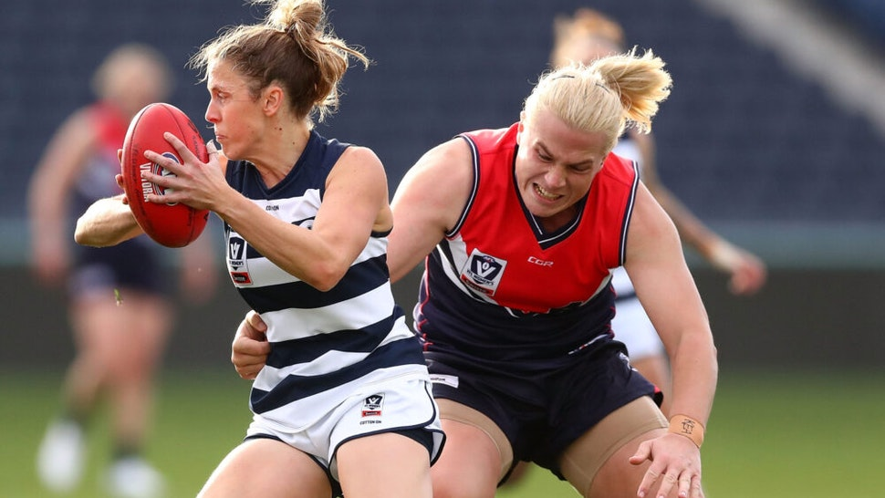 GEELONG, AUSTRALIA - JUNE 16: Anna Teague of the Cats is tackled by Hannah Mouncey of the Falcons during the round six VFLW match between Geelong and Darebin at GMHBA Stadium on June 16, 2018 in Geelong, Australia.