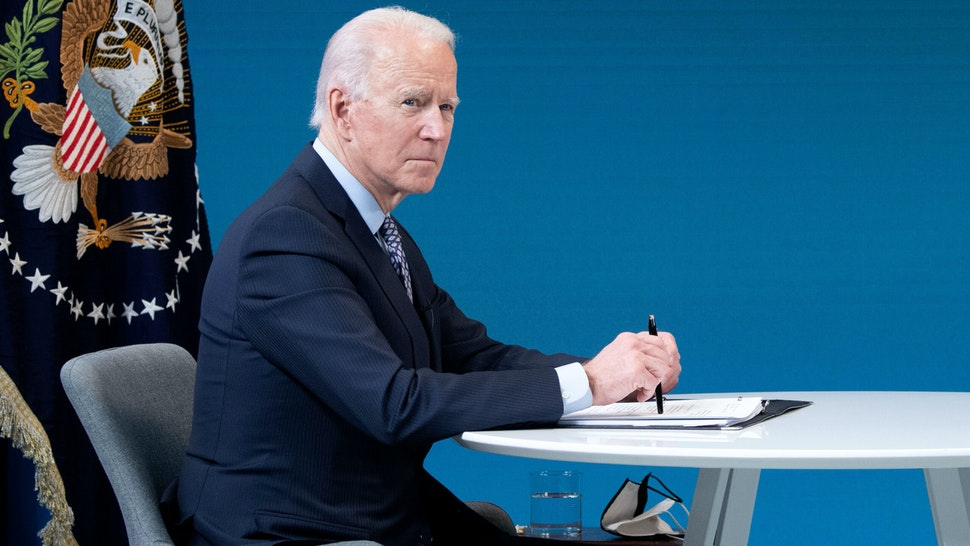 US President Joe Biden speaks during a virtual National Governors Association's Winter Meeting in the Eisenhower Executive Office Building in Washington, DC, February 25, 2021.