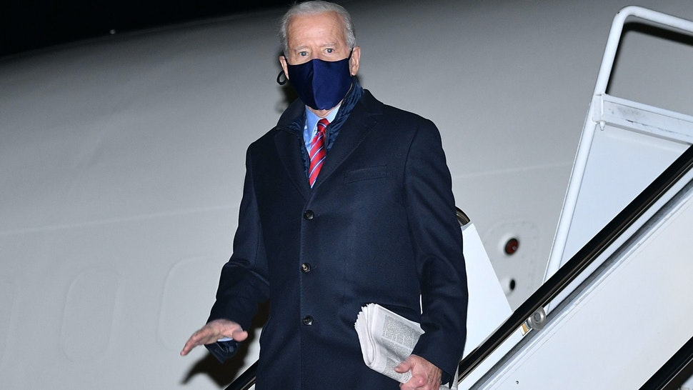 US President Joe Biden steps off Air Force One upon arrival at New Castle Airport in New Castle, Delaware on February 5, 2021. - Biden is due to spend the weekend in Wilmington, Delaware.