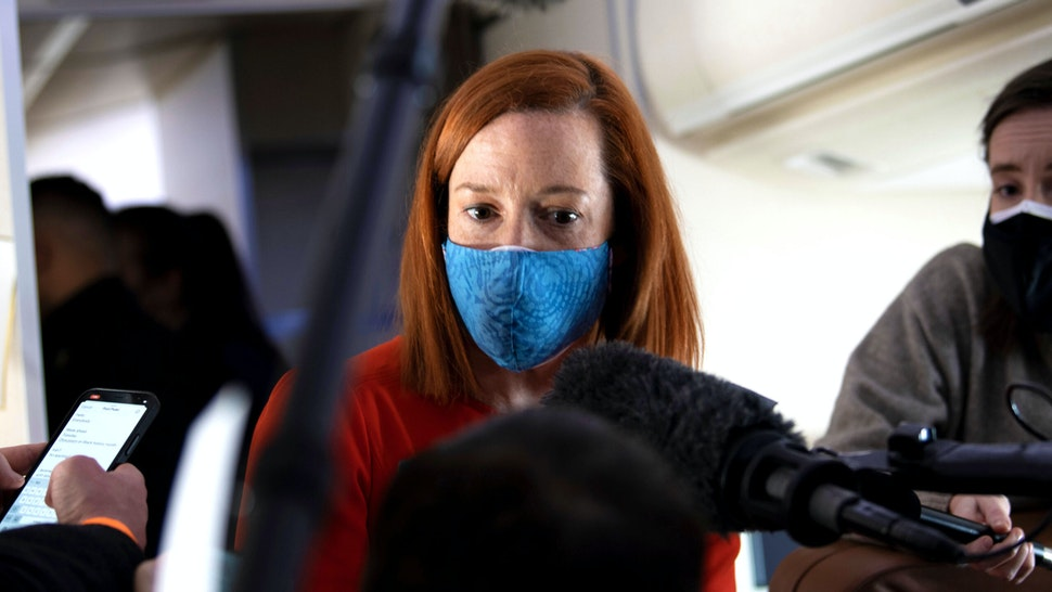 White House Press Secretary Jen Psaki speaks to reporters onboard Air Force One, February 19, 2021 following a visit to the Pfizer Kalamazoo Manufacturing Site in Michigan.