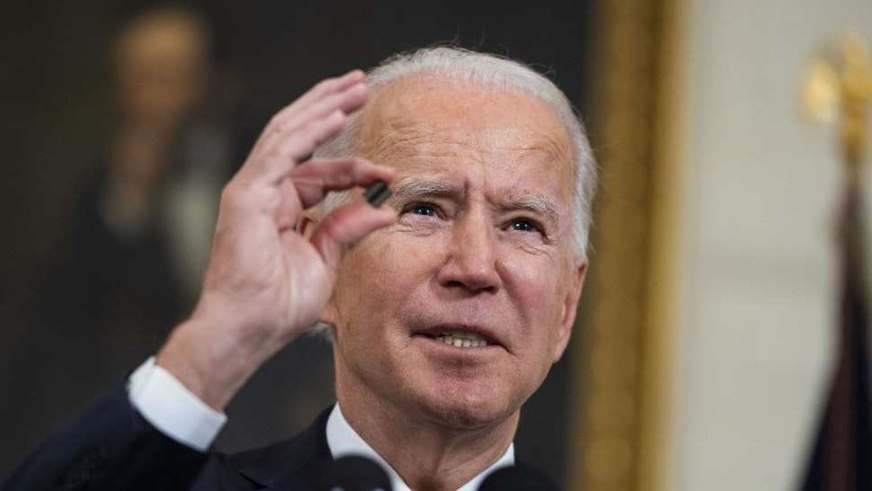 U.S. President Joe Biden holds a semiconductor before signing an executive order in the State Dining Room of the White House in Washington, D.C., U.S., on Wednesday, Feb. 24, 2021. Biden ordered a government review of U.S. supply chains, seeking to end the country's reliance on China and other adversaries for crucial goods. Photographer: Doug Mills/The New York Times/Bloomberg
