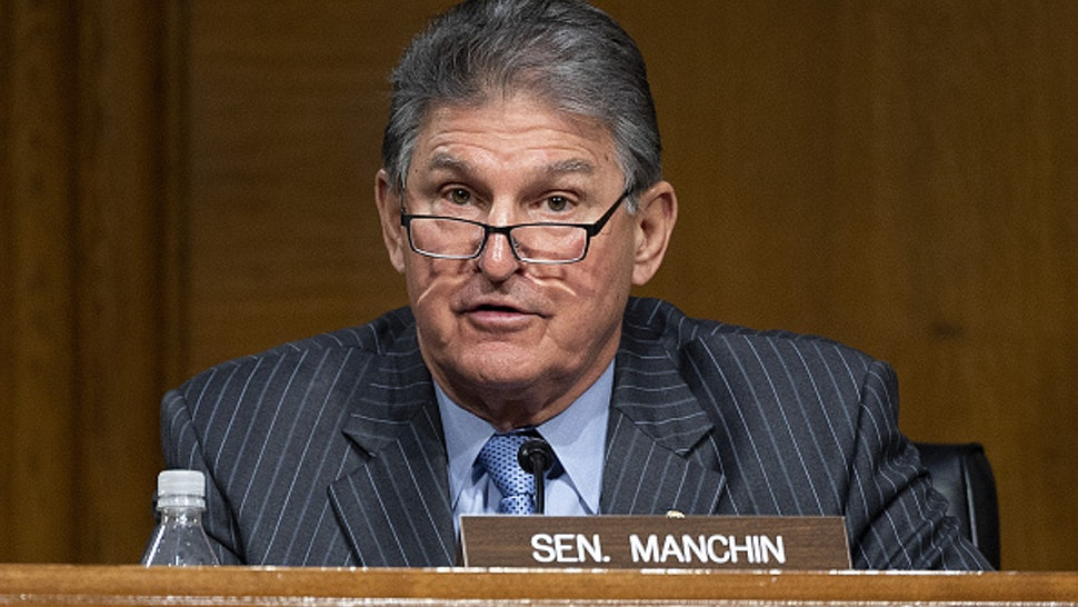 Senator Joe Manchin, a Democrat from West Virginia and ranking member of the Senate Energy and Natural Resources Committee, speaks during confirmation hearing for Jennifer Granholm, U.S. secretary of energy nominee for U.S. President Joe Biden, in Washington, D.C., U.S., on Wednesday, Jan. 27, 2021. Granholm, the former governor of the politically pivotal state of Michigan, if confirmed will lead the Department of Energy which is expected to play an enlarged role in the battle against climate change.