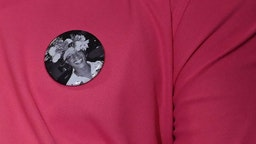 A man wears a button with a picture of transgender activist Marsha P. Johnson during an event at the The Lesbian, Gay, Bisexual & Transgender Community Center in New York on May 30, 2019. - Mayor Bill de Blasio announced the next She Built NYC monument that will honor pioneering transgender activists Marsha P. Johnson and Sylvia Rivera, key leaders in the Stonewall Uprising that sparked the gay liberation movement and the modern fight for LGBTQ rights in the US.