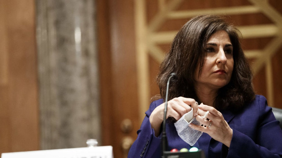 Neera Tanden, director of the Office and Management and Budget (OMB) nominee for U.S. President Joe Biden, removes her mask during a Senate Homeland Security and Governmental Affairs Committee confirmation hearing in Washington, D.C., U.S., on Tuesday, Feb. 9, 2021. Tanden, who pledged to work with both parties after drawing sharp criticism from Republicans for sniping at them on social media, worked on the Affordable Care Act during the Obama years and was an aide to Hillary Clinton from her time as first lady.