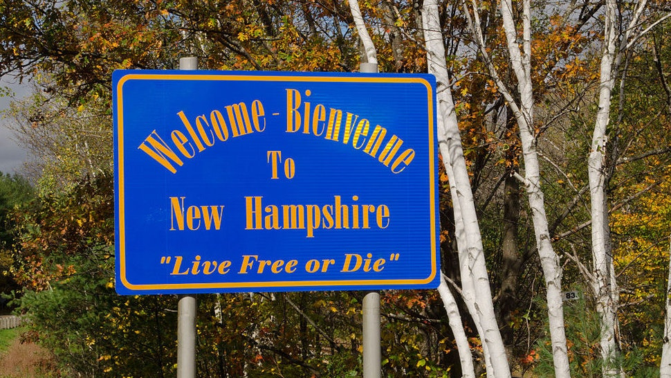 Welcome to New Hampshire sign in Northern New England in fall foliage