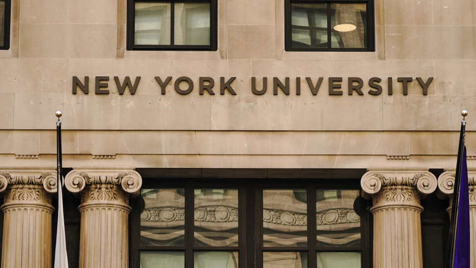 A view of New York University sign on the campus building.