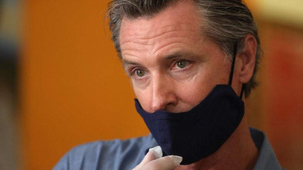 LOS ANGELES, CA - JUNE 03, 2020 - - California Governor Gavin Newsom is interviewed while visiting the Hot and Cool Cafe in Leimert Park after several days of protest in Los Angeles on June 3, 2020.