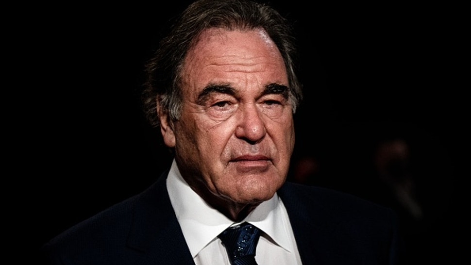 US film director Oliver Stone arrives for the opening ceremony of the 12th edition of the Lumiere Film Festival in Lyon, central eastern France, on October 10, 2020.