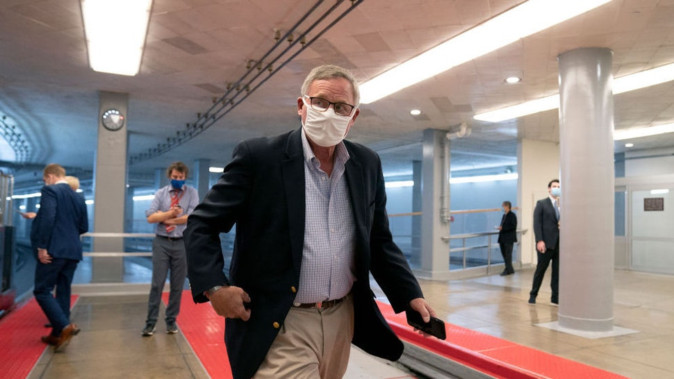 WASHINGTON, DC - DECEMBER 11: U.S. Sen. Richard Burr (R-NC) wears a protective mask while walking through the Senate Subway at the U.S. Capitol on December 11, 2020 in Washington, DC. The Senate passed a one week stop-gap bill on Friday, avoiding a partial government shutdown.