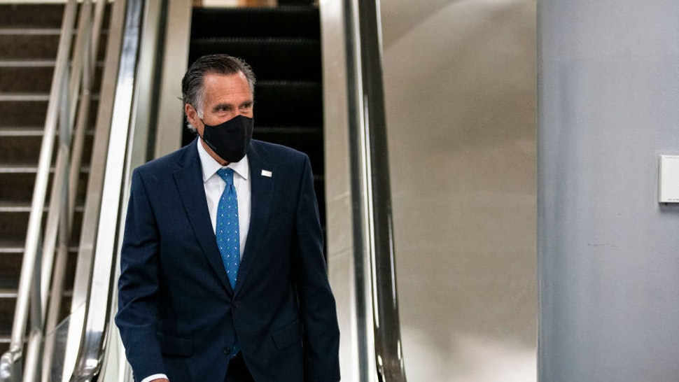 WASHINGTON, DC - FEBRUARY 23: Sen. Mitt Romney (R-UT) departs following a vote in the subway of the U.S. Capitol on February 23, 2021 in Washington, DC. The Senate held confirmation hearings today for multiple Biden administration nominees as well as a hearing regarding the January 6 attack on the U.S. Capitol.