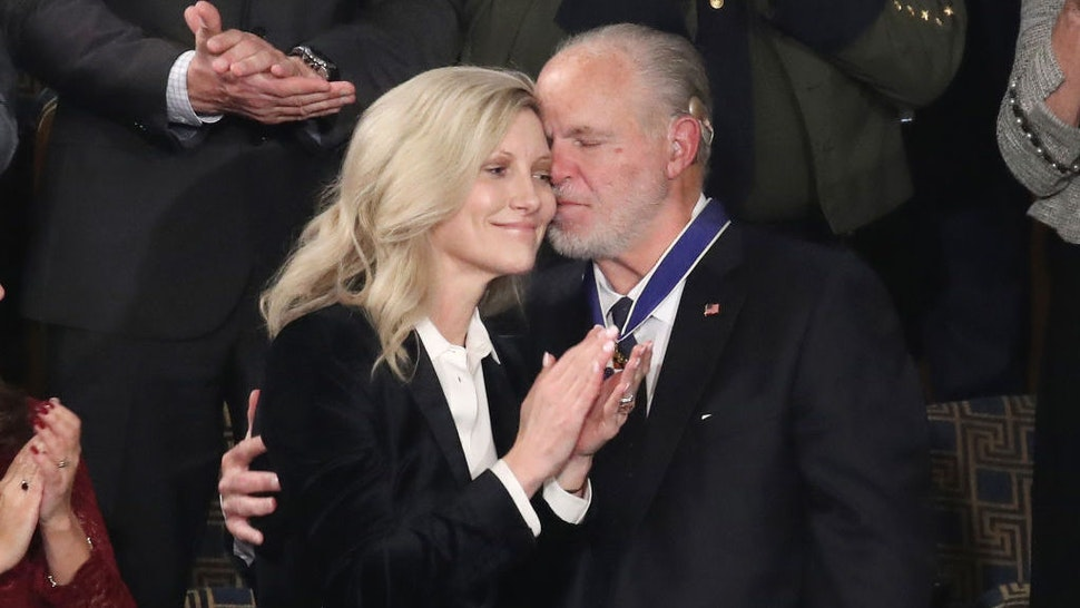 WASHINGTON, DC - FEBRUARY 04: Radio personality Rush Limbaugh embraces his wife Kathryn Adams Limbaugh after First Lady Melania Trump gives him the Presidential Medal of Freedom during the State of the Union address in the chamber of the U.S. House of Representatives on February 04, 2020 in Washington, DC. President Trump delivers his third State of the Union to the nation the night before the U.S. Senate is set to vote in his impeachment trial. (Photo by Drew Angerer/Getty Images)