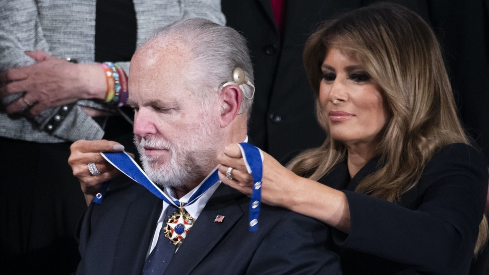 UNITED STATES - FEBRUARY 04: First Lady Melania Trump awards Rush Limbaugh the Presidential Medal of Freedom during President Donald Trumps State of the Union address in the House Chamber on Tuesday, February 4, 2020.